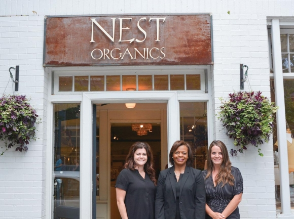Cheri Beasley visits with Lyndsey Marlar and Katie Spears, owners of Nest Organics in Asheville.